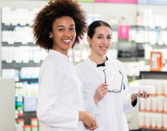 two pharmacists looking at camera