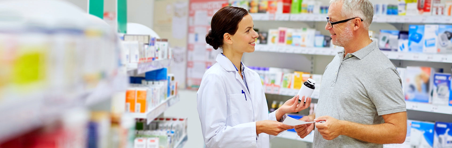 pharmacist and a customer smiling