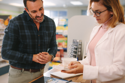 pharmacist suggesting medicine to a customer in a pharmacy