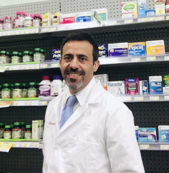 pharmacist showing a medicine to a customer