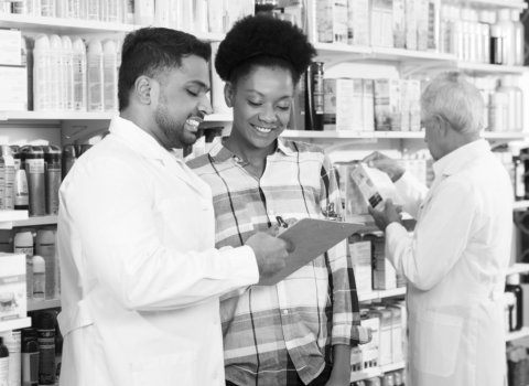 pharmacist showing medicine to a customer