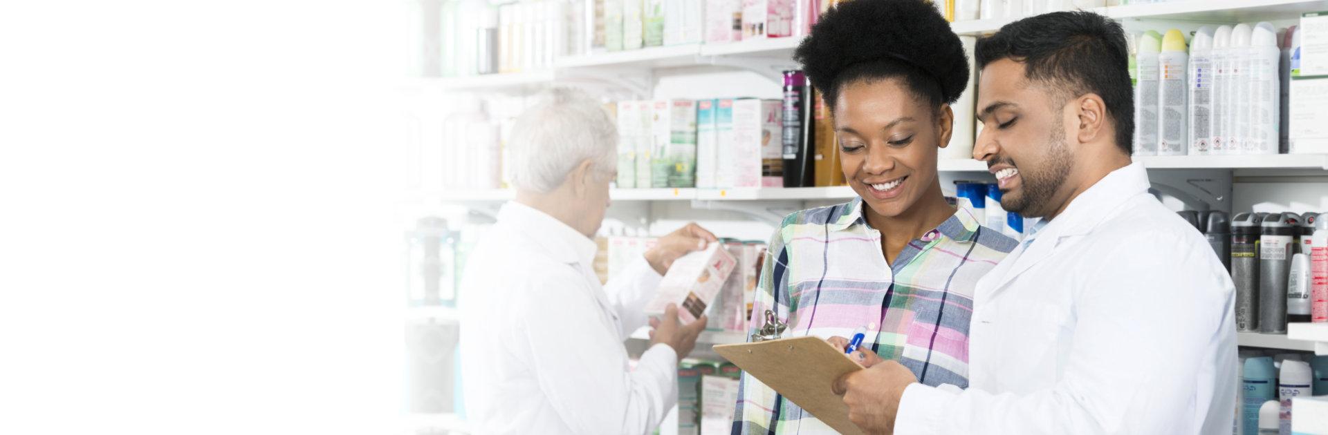 pharmacist explaining prescription to customer
