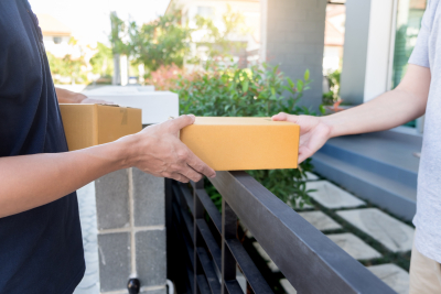 delivery service hading a package to a customer