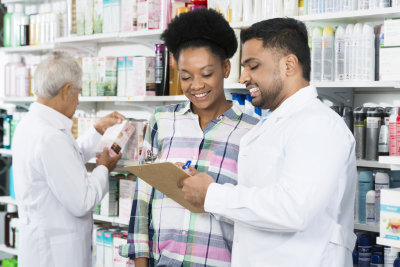 pharmacist prescription to customer in pharmacy