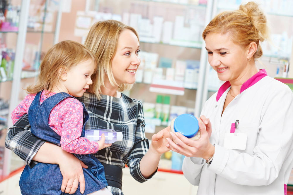 mother and daughter with a pharmacist